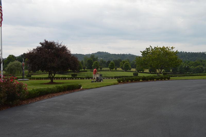 Driveway Landscape and Manicured Lawn