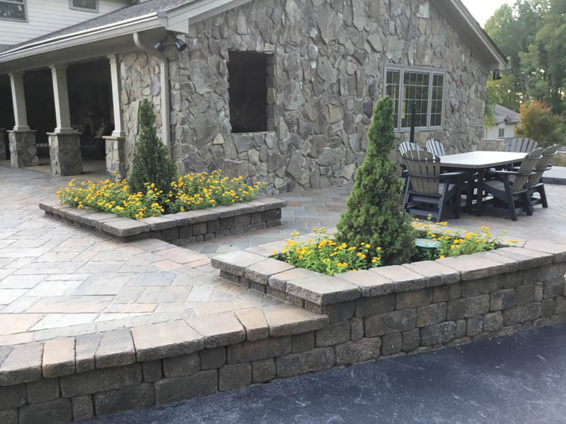 Patio with stone flower beds